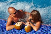 pic of hot-tub  - Romantic couple with coconut drink relaxing in hot tub - JPG