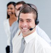 Cheerful Customer Service Representatives Standing In A Line