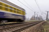 stock photo of passenger train  - Electric passenger train traveling on the railroad tracks - JPG