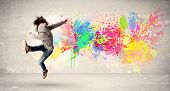 pic of break-dance  - Happy teenager jumping with colorful ink splatter on urban background concept - JPG
