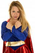stock photo of short-story  - A woman in her super hero costume with a serious expression with her wrists crossed - JPG