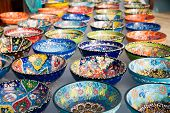 picture of pottery  - Collection of turkish traditional handpainted pottery bowls in souvenir shop - JPG
