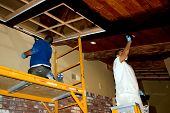 picture of stripping women window  - two workers stripping and painting beams - JPG