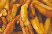 picture of solanum tuberosum  - Golden French fries potatoes ready to be eaten - JPG