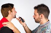 pic of electric trimmer  - Barber trimming a beard with an electric razor - JPG