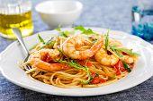 stock photo of spaghetti  - Spaghetti with prawncherry tomato and rocket  - JPG