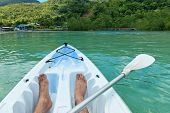 picture of canoe boat man  - Man canoeing in the Seychelles off the coast of Mahe island near Port Launay - JPG