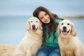 image of labrador  - Portrait of a beautiful young woman and her friend labrador dog on a wild beach in autumn - JPG