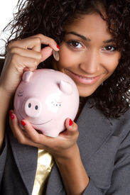 picture of save money  - Black woman saving money with piggy bank - JPG