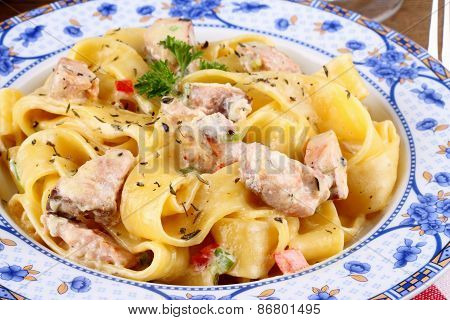 Fish Salmon Fillet And Tagliatelle Noodle With Cream Sauce