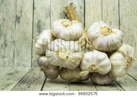 Group Of Garlic On Wooden Plank, Still Life Style