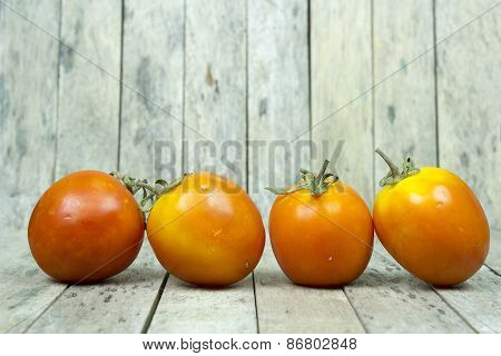 Group Of Tomato On Wooden Plank, Still Life Style