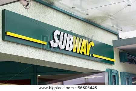 The subway sign above the entrance door