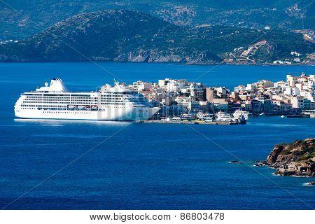 White Passenger Ship Off The Coast Of Agios Nikolaos. Crete, Greece