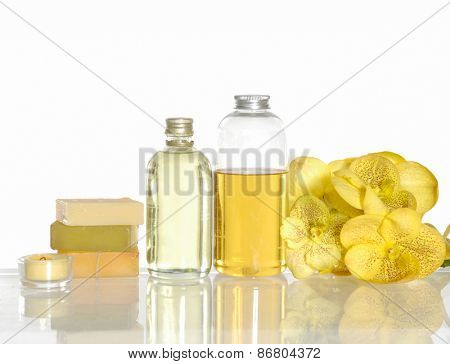 Yellow orchid with massage oil ,candle, soap on white background
