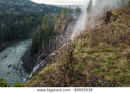 Stream Of Water Spewing From Cliff