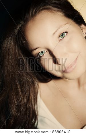 Young Brunette Woman With Green Eyes