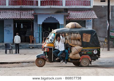 Indian Rickshaw Full Of Bags On The Road