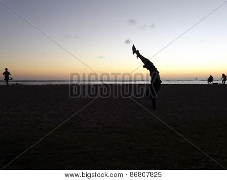 Man Handstands On Ala Moana Beach At Dusk