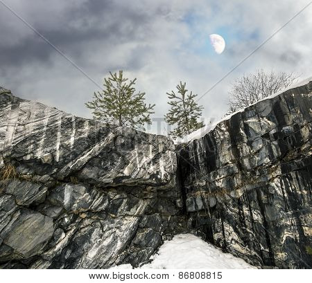 Harsh Northern Misty Landscape With Moon. Ruskeala Marble Quarries In Karelia
