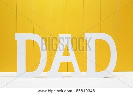 Dad Text Letters On Yellow Wooden Background