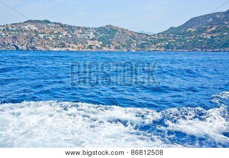 Ocean landscape with boat seafoam