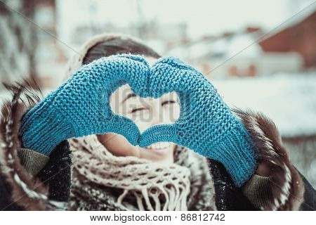 Pretty Girl With Heart Shaped Hands In The Gloves