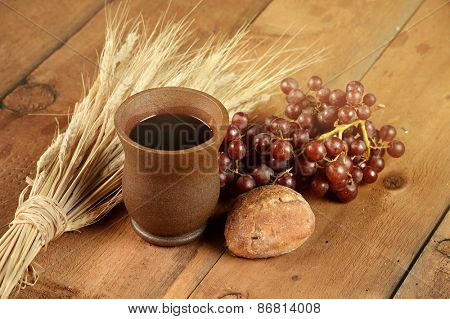 Communion elements with wine and bread on wooden table