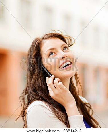 young woman talking on the phone outdoors