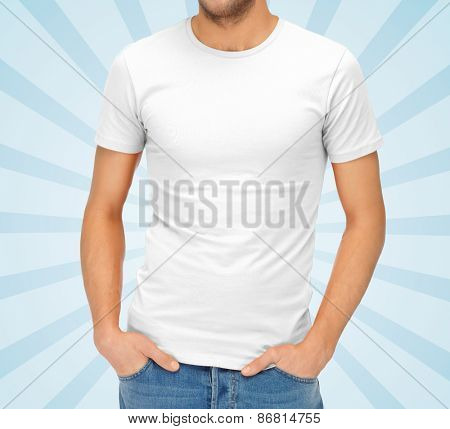 clothing design, advertisement, fashion and people concept - close up of ma in blank white t-shirt over blue burst rays background