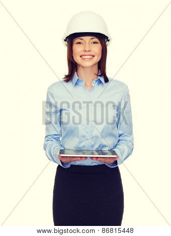 building, developing, consrtuction and architecture concept - friendly young businesswoman in white helmet with tablet pc computer