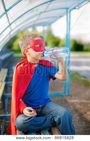 Superhero Drinking Water From A Bottle