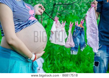Happy Pragnant Women With Husband Outdoor In The Garden