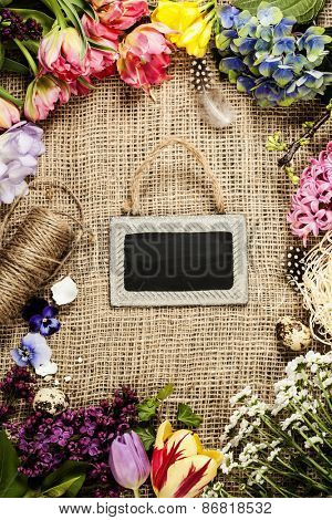 Easter background with eggs, nest and flowers