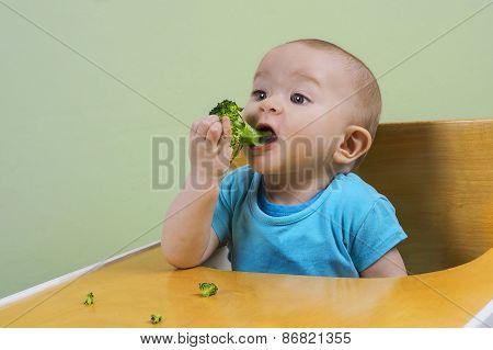 Funny Baby Eating Broccoli