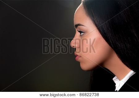 Profile Portrait Of Beautiful Young Lady