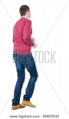 back view of running man in blue pullover. walking guy in motion. Rear view people collection.  backside view of person. Isolated over white background.