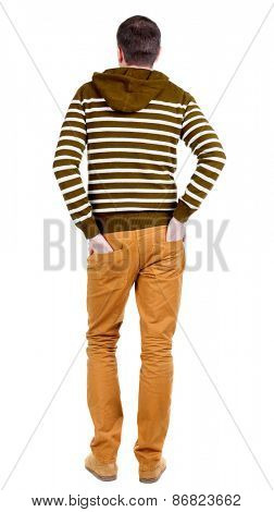 Back view of handsome man in striped hooded sweater. Standing young guy in jeans. Rear view people collection.  backside view of person.  Isolated over white background.