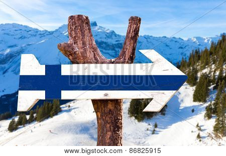 Finland flag wooden sign with alps background