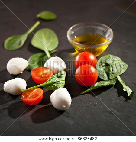 Mozzarella Cheese with Tomato and Green Leaves