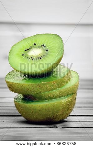 Kiwi On Wooden Table