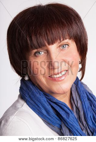 Smiling mature woman. Happy female. Studio shot