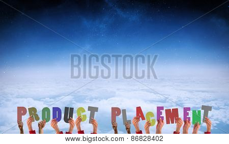 Hands showing product placement against white clouds under blue sky