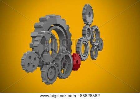 Cogs and wheels against yellow background with vignette