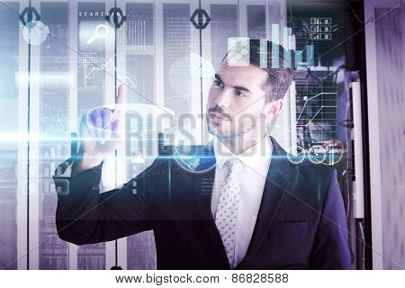 Thoughtful businessman pointing something with his finger against data center