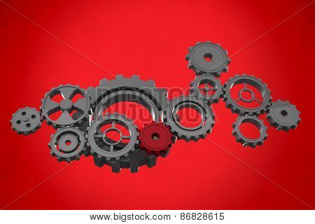 Cogs and wheels against red background