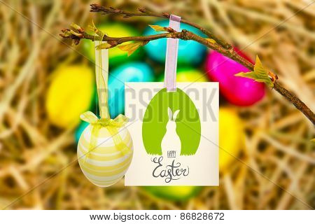 happy easter graphic against easter eggs grouped together on straw