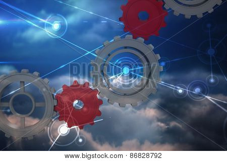 Cogs and wheels against lines against glowing sky