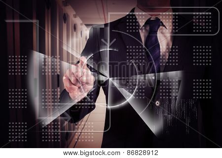 Businessman in suit pointing finger against data center