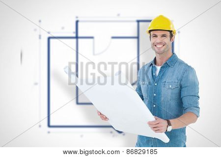 Happy architect holding blueprint in house against blueprint